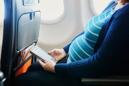 10 Safety Concerns for Flying During Pregnancy - Pregnant Woman Traveling by Plane